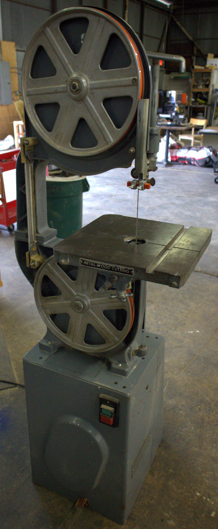 A band saw able to cut metal or wood depending on the blade and speed.